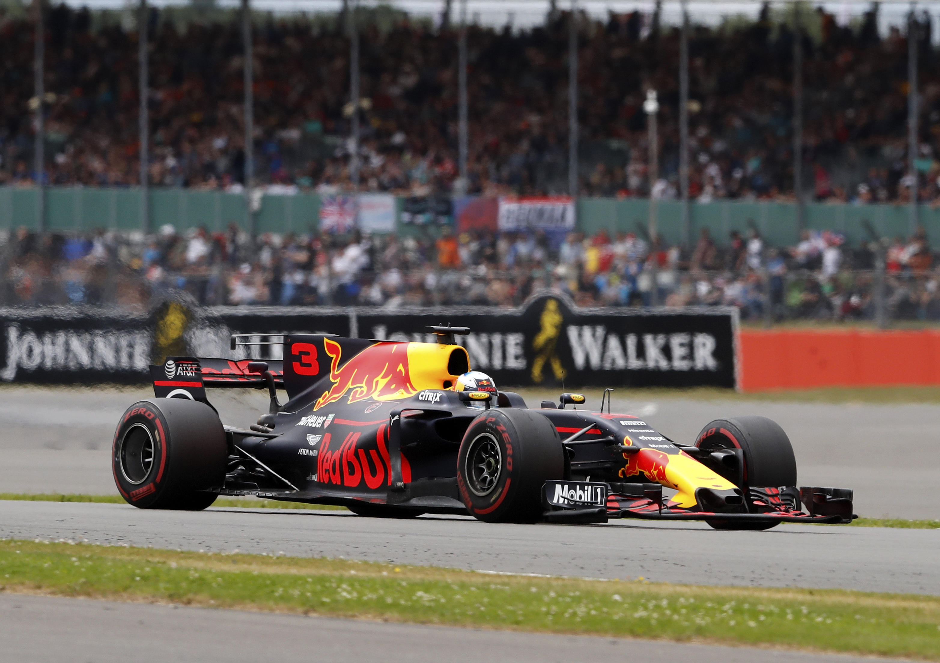 Red Bull driver Daniel Ricciardo of Australia steers his car during the British Formula One Grand Prix at the Silverstone racetrack in Silverstone, England, Sunday, July 16, 2017. (AP Photo/Frank Augstein)